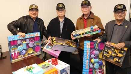 Community members & Veterans donate to the toy drive